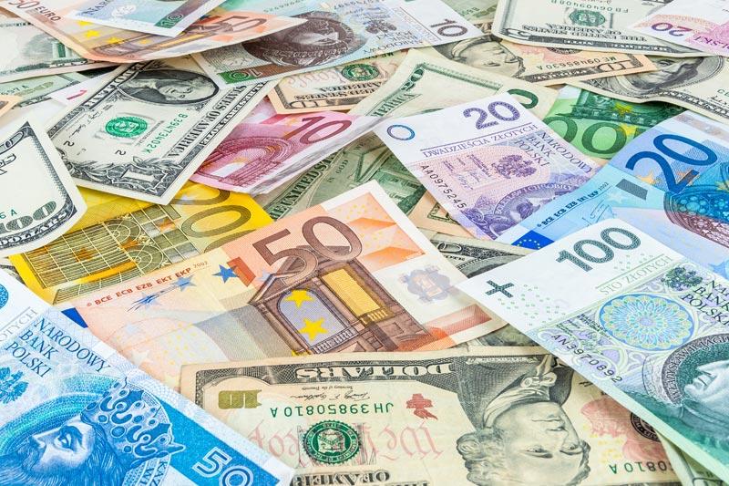 新兴市场债该选美元还是当地币别