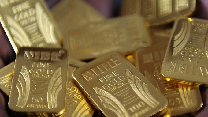 Fed升息美元上涨黄金收低11.70美元